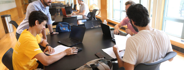 Students collaborating in the Wharton MBA joint degree program.